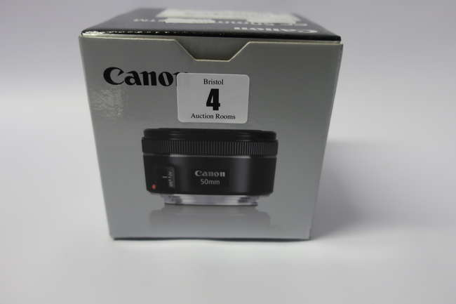 A boxed as new Canon EF 50mm f/1.8 STM lens.