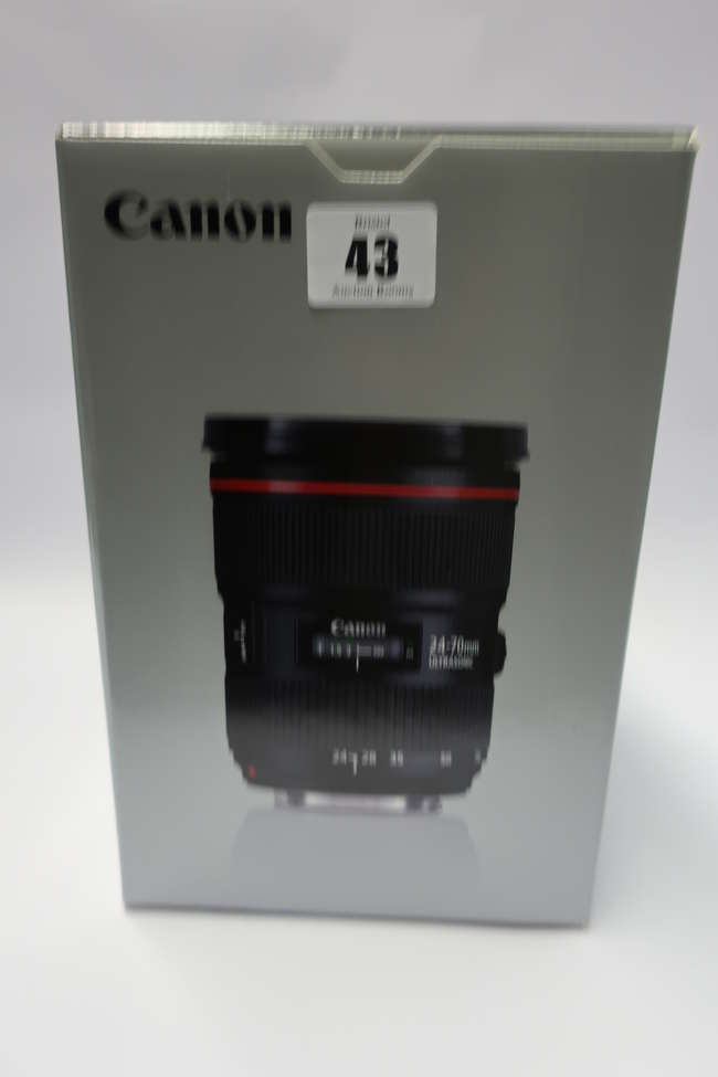 A boxed as new Canon EF 24-70mm f/2.8L II USM Zoom Lens with LP1219 Lens Case and EW-88C Lens Hood.