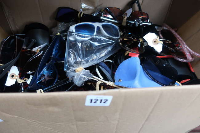 A box of unbranded sunglasses.