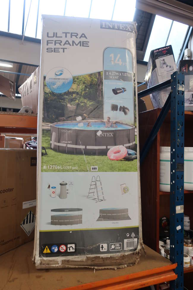 A boxed as new Intex ultra frame set 14ft swimming pool (Damage to box).