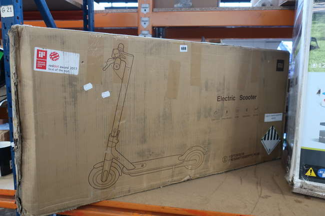 A boxed as new Xiaomi Mi electric scooter.