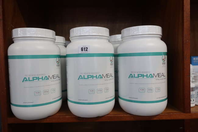 Nine Alpha Meal grass fed whey protein powder in cinnamon ice cream flavor.