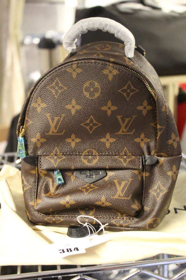 An as new Louis Vuitton Palm Springs Monogram mini brown bag (M41562) bearing the date stamp FL2118 complete with dust bag.