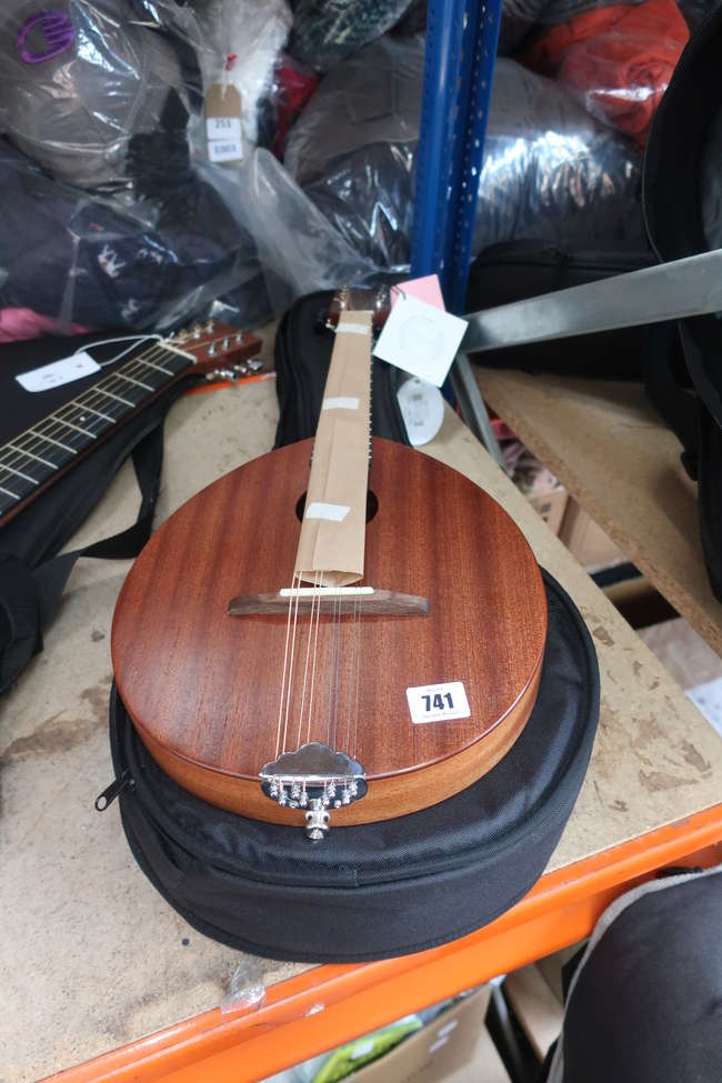 An as new Ashbury mandolin and carry case (AM-110).