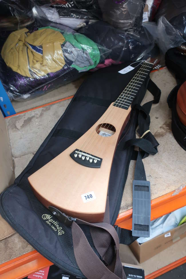 An as new Martin Backpacker Acoustic LH guitar with canvas case (Serial number; 275437).