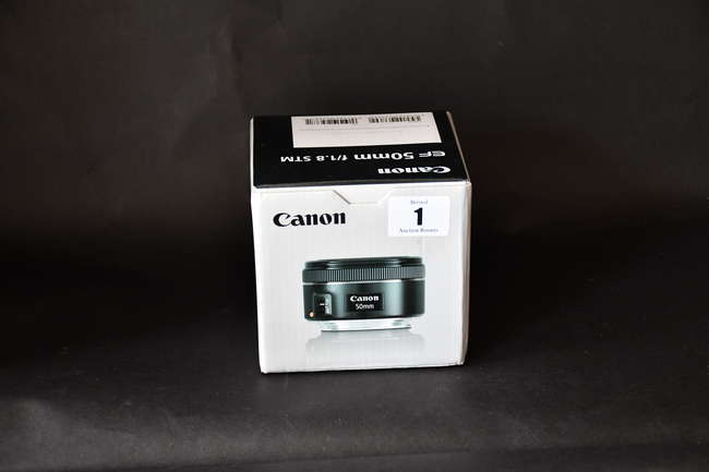 A boxed as new Canon EF 50 mm 1.8 STM Lens (Box opened).