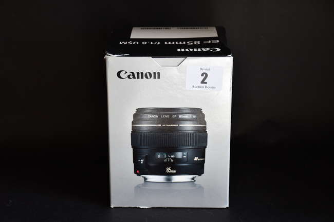 A boxed as new Canon EF 85mm f/1.8 USM Lens (Box opened).