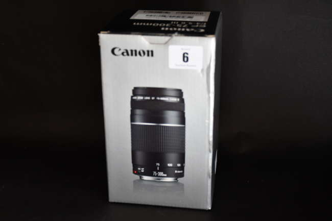 A boxed as new Canon EF 75-300 mm f/4.0-5.6 III Lens (Box opened).