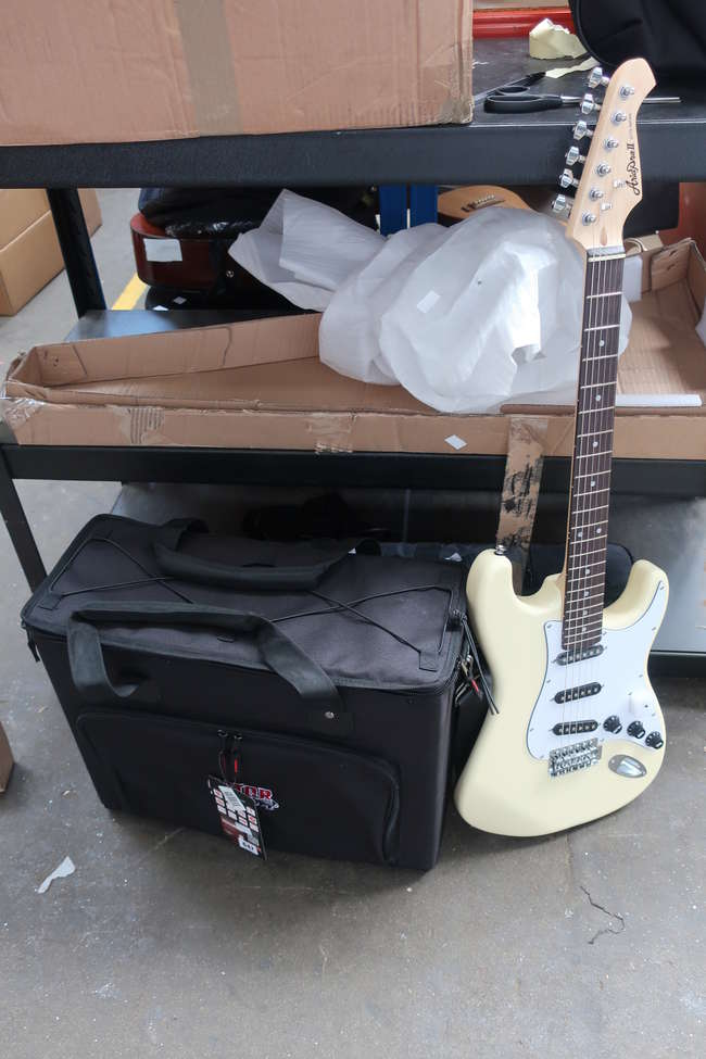 One boxed as new Aria Pro II STG-003SPL electric guitar and one as new Gator GRB-4U audio rack bag.