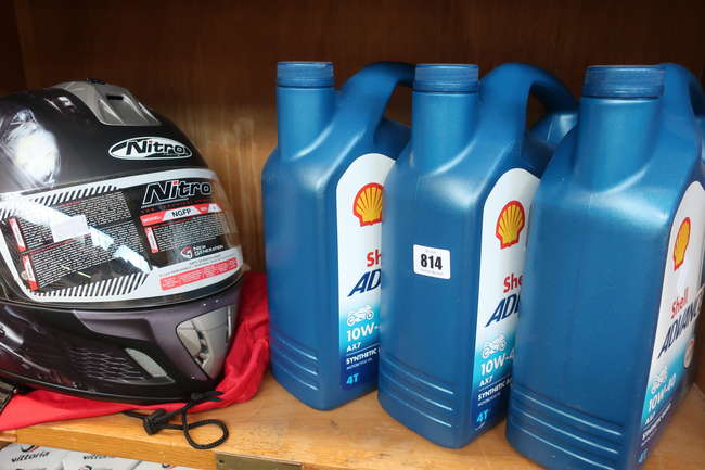 One as new Nitro racing NGFP motorcycle helmet (M) and three bottles of Shell Advance 10W-40 AX7 motorcycle oil (4ltr).