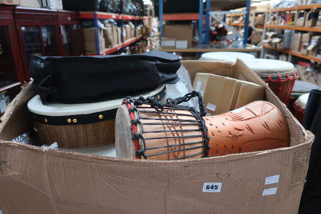 A quantity of as new percussion instruments to include Djembe drum and a Kogna drum.