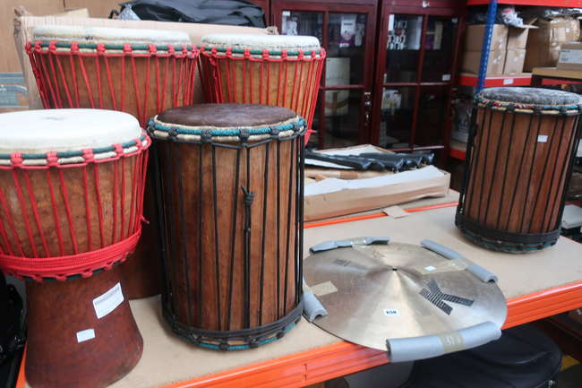 A quantity of as new and used percussion instruments to include drums and symbol.