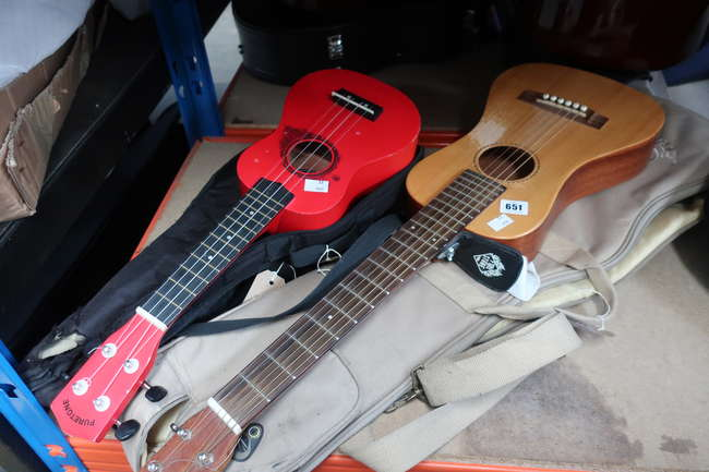 A pre-owned Mahalo Ukulele and a pre-owned PureTone Ukulele., a pre-owned Traveller guitar.
