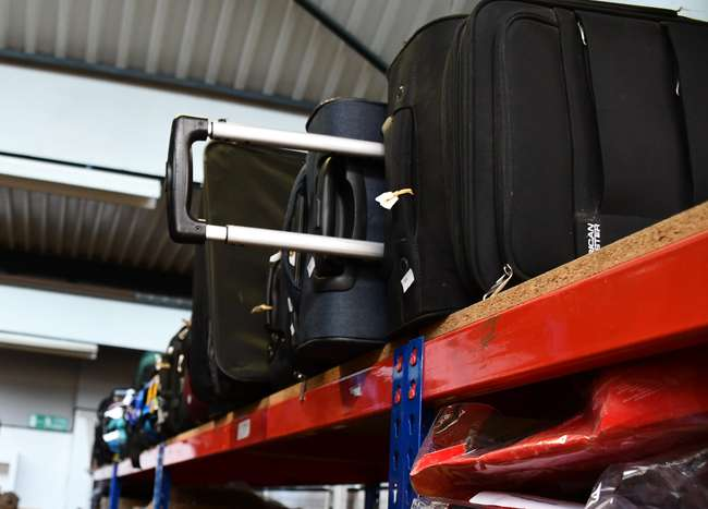 A quantity of empty suitcases/holdalls and related items.