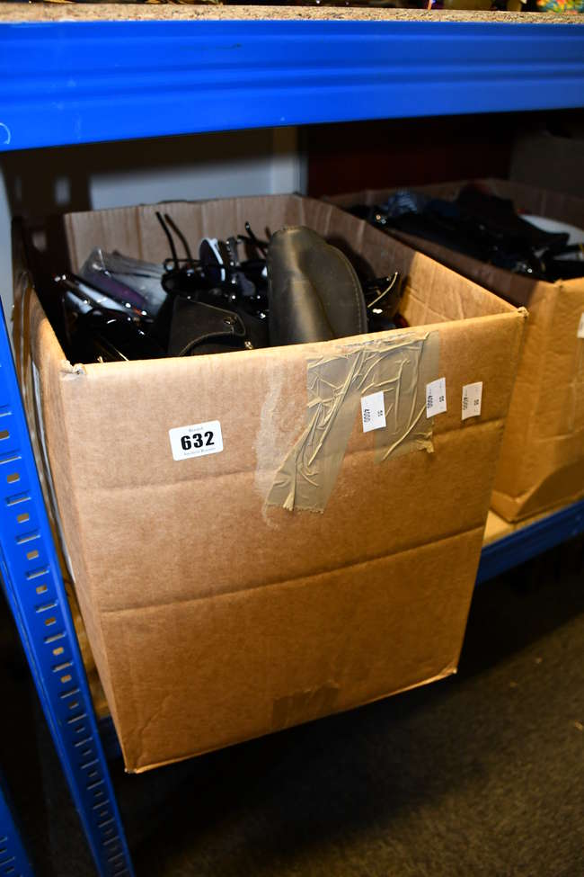 A box of assorted unbranded sunglasses.