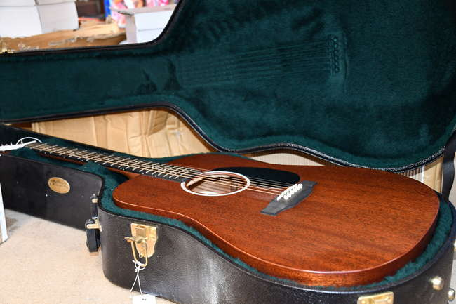 One as new Martin & Co DRS-1 Road Series Acoustic Guitar in a black case.