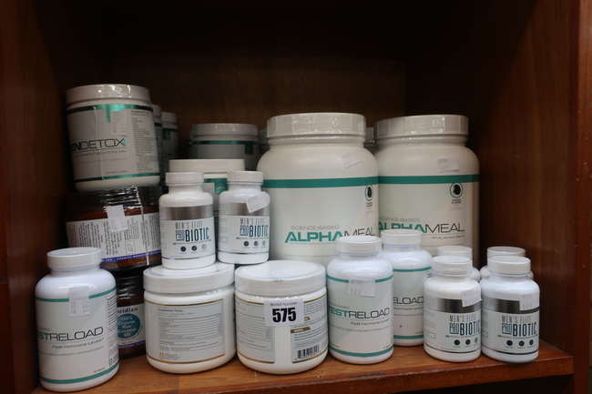 A large quantity of health and fitness related items to include Science Based green detox and Mens Elite Pro Biotics.
