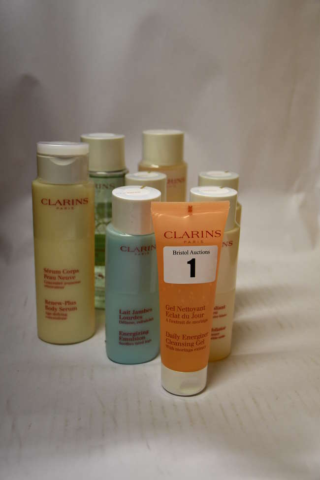 Twelve assorted Clarins skin care products including Renew-Plus body serum (200ml), body ltion (200ml), facial cleanser (200ml), cleansing milk (200ml), gentle exfoliator (125ml), energizing emulsion (125ml) and cleansing gel (75ml).