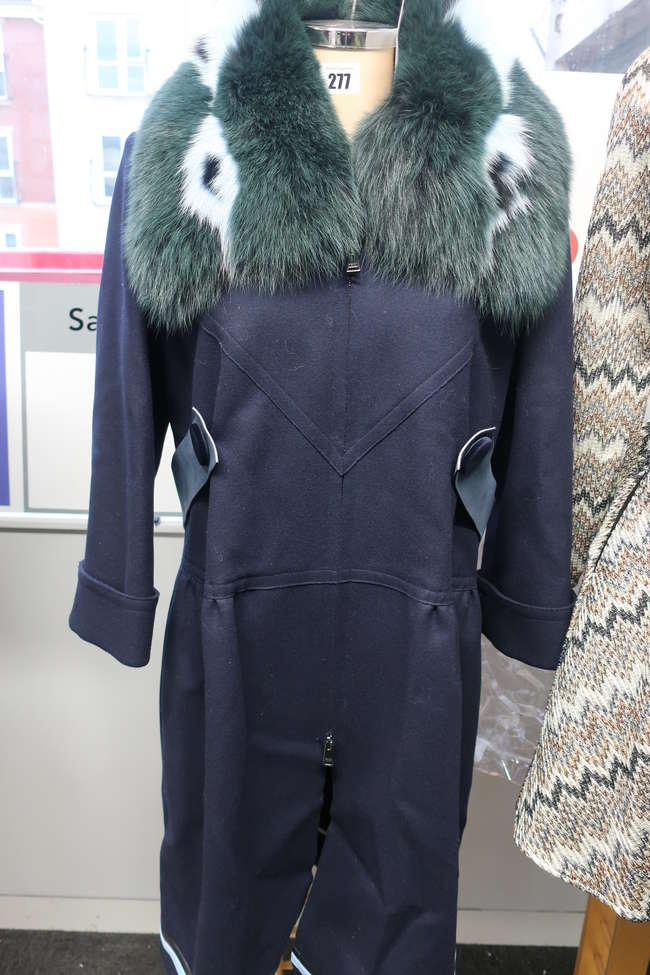 A Fendi fur trimmed knee length coat with tags (48) from The Real Real.