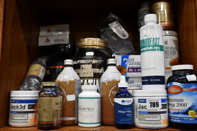 A quantity of as new health and fitness supplements to include Optimum Nutrition Gold Standard whey protein, USP labs Jak3d pre workout and Pure Protein chewy chocolate chip bars.