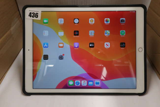 A pre-owned Apple iPad Pro 12.9 (Wi-Fi/Cellular) A1652 128GB in Silver (IMEI: 355656070388434) (Activation clear) with a black leather Zugu Case.
