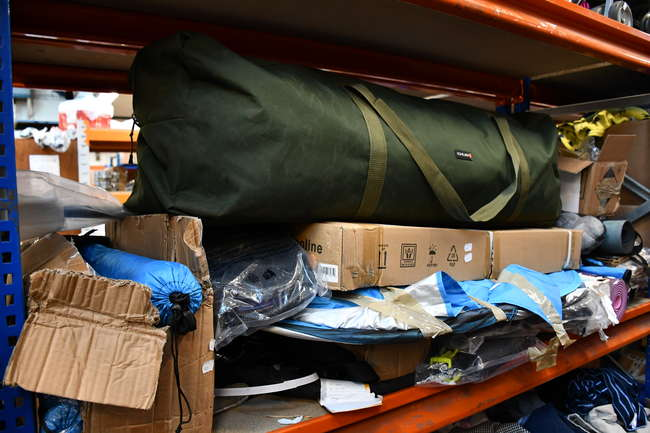 A quantity of miscellaneous sports and leisure items to include tents, mini trampoline and yoga mats.