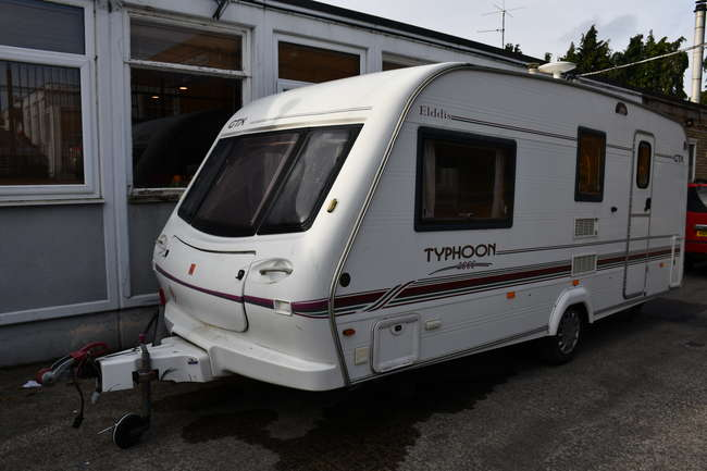 An Elddis GTX 2000 Typhoon three berth single axle caravan with end washroom, side dinette, cooker, fridge with freezer compartment and JVC stereo (Chassis no: SGESPL1ELYGX40111).