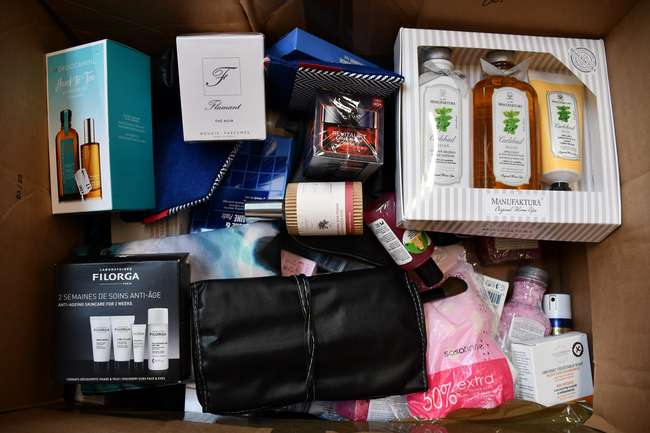 A box of as new assorted beauty products.