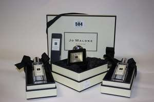Assorted Jo Malone products; two Wood Sage & Sea Salt colognes (30ml), Dark Amber & Ginger Lily cologne intense (50ml), vitamin E lip conditioner (15ml) and a Wood Sage & Sea Salt set comprising of cologne (30ml), body and hand wash (100ml) and body