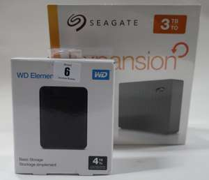 A Seagate Expansion 3TB desktop drive and a WD Elements 4TB basic storage (Both as new).