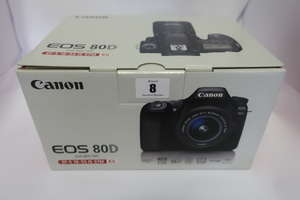 A boxed as new Canon EOS 80D (W) Digital SLR Camera with 18-55mm IS STM Lens in Black.