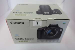 A boxed as new Canon EOS 1300D (W) Digital SLR with EF-S 18-55mm III Lens.