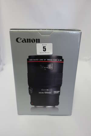 A boxed as new Canon EF 100mm f/2.8L IS USM Macro Lens for Canon Digital SLR Cameras with a LP1219 lens case and a ET-73 lens hood.