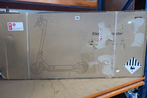 A boxed as new Xiaomi Mi electric scooter