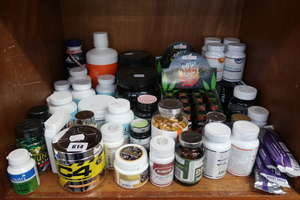 A quantity of health supplements and related items.