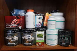 A quantity of health and fitness supplements to include Science Based Alpha Meal and Muscletech Platinum Creatine.  (approximately twenty items).