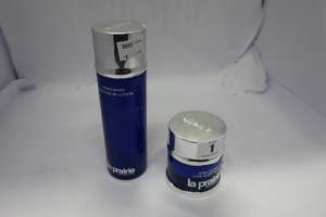 A La Prairie skin caviar mask (Seal slip and unused) and a La Prairie lotion essentielle caviar luxe.