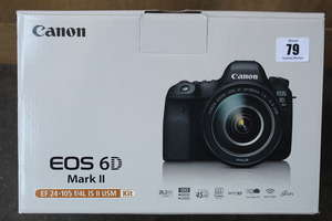A boxed as new Canon EOS 6D Mark11 OSLR camera and EF-105 F/L IS 11 WM lens kit