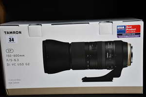 A boxed as new Tamron...