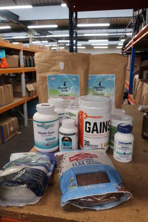 A quantity of as new vegan and heathy living supplements to include Organic Tree organic pea protein and Kinobody Gains Arrowhead organic flax seeds etc.