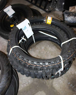 Four Dunlop motorcycle tyres; 100-19-S7-M-DM52 and 100-90-19-57M.