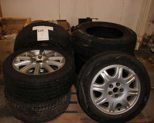 Two Ford alloy wheels R17 and R18, one steel wheel R16, one alloy wheel R15 and three part used tyres.