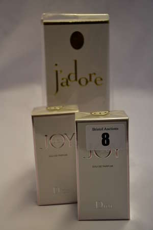 One Dior J'adore eau de parfum (150ml) and two Dior Joy eau de parfum (30ml), all boxed as new.