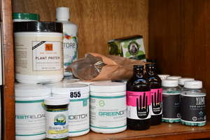 A large quantity of health and fitness supplements to include Science-Based green detox drink, WeCareSpa plant protein powder and YUMI vitamin C&E capsules.