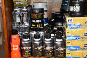 A large quantity of health and fitness supplements to include Optimum Nutrition gold standard whey protein powder, Dark Metal Manson pre workout powder and Muscle Tech post workout L-Carnitine drinks