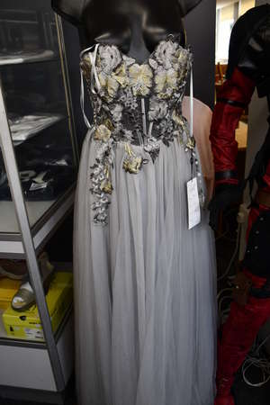 An as new X & M Collection 4392 prom/wedding gown (Size 40).