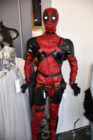 A replica Deadpool costume to include bodysuit, mask, gloves, shoes and holsters.