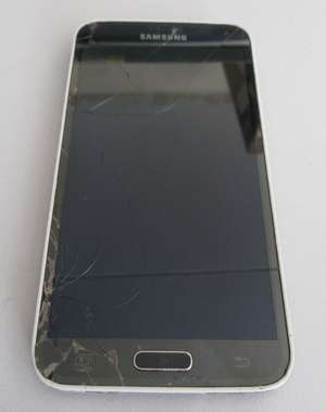 A used Samsung Galaxy S5 Android mobile phone SM-G900F. Screen and rear damaged. Activation clear. IMEI 353801066510862. Sold for spares or repair, phone only.