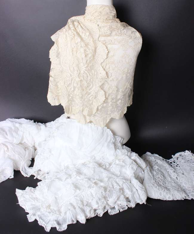 Two late 19th/early 20th Century cream lace-trimmed children's capes