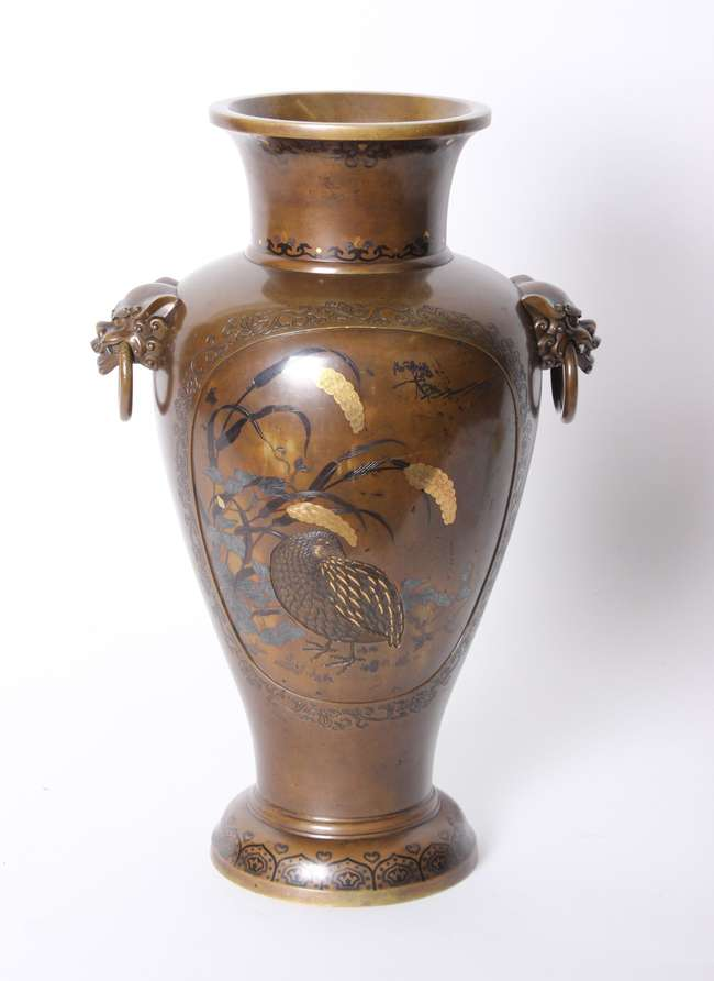 A Japanese style bronzed vase with lion mask ring handles 43cm high